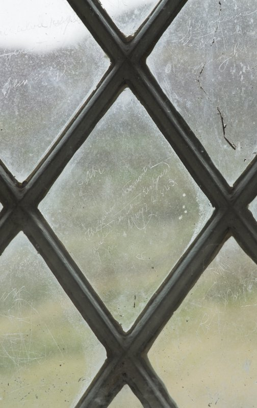 East window. Detail of writing etched on glass. (Image reversed for legibility.) 'The Glencalvie tenants reside in the kirkyard here May 24 1845'