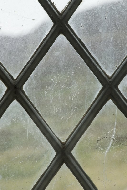 East window. Detail of writing etched on glass. (Image reversed for legibility.) 'John Ross Shepherd Croick May 15 1869'