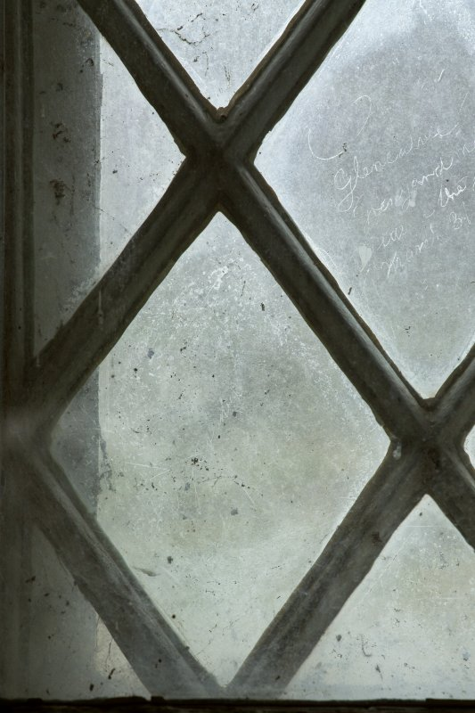 East window. Detail of writing etched on glass. (Image reversed for legibility.) 'The Gencalvie amat'
