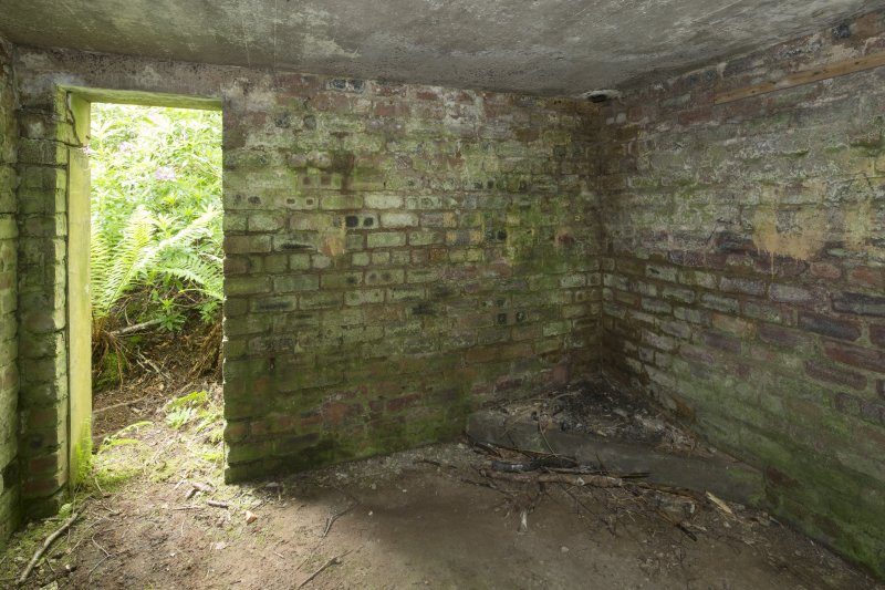 Ex D.O. post.  Interior view of stove base in south east corner of observation room.