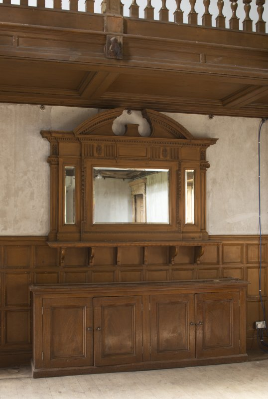 Ground floor, hall, view of sideboard with mirror above at east end