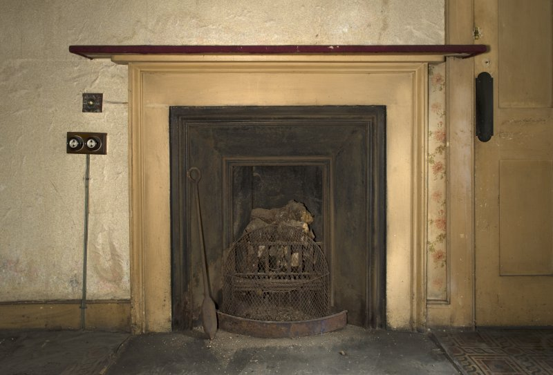 Ground floor, south west (housekeeper's) room, detail of fireplace