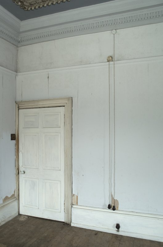 1st floor, south east bedroom, view of door and electric pull cord