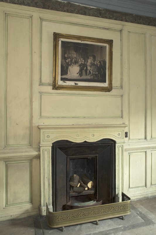 1st floor, south west bedroom, view of fireplace and overmantle  on south wall