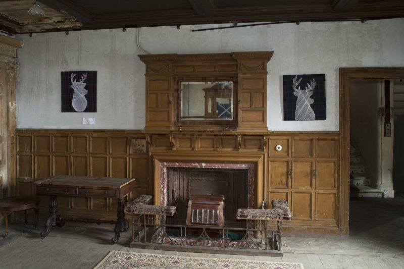 Ground floor, hall, view of fireplace at west end