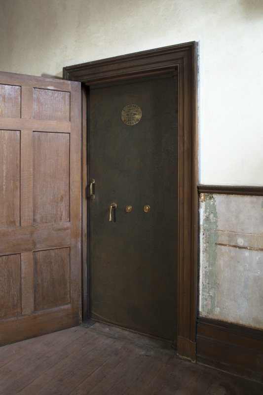 Ground floor, stair hall, view of safe behind door