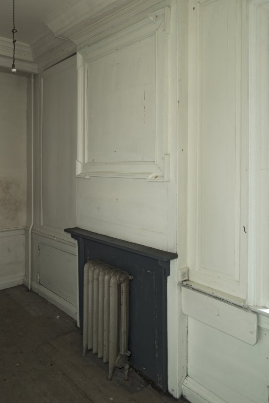 Ground floor, gun room, view of fireplace and panelling