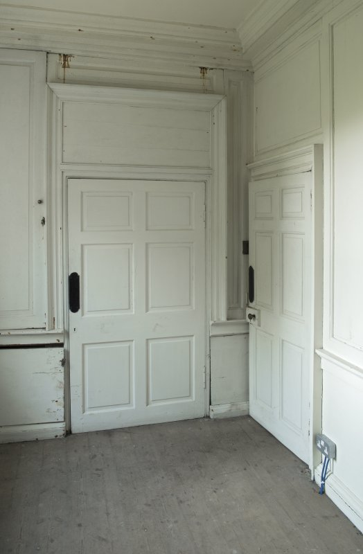 Ground floor, gun room, view of door and panelling