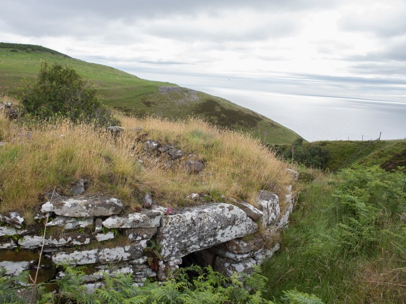 View across Ousdale Burn broch, facing east, including lintel over entrance passage