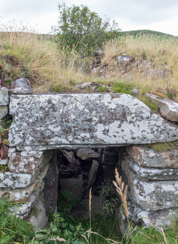Detailed view showing lintel stone over main passage entrance at Ousdale Burn broch