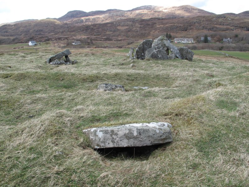 Possible kerb stone at SW of cairn