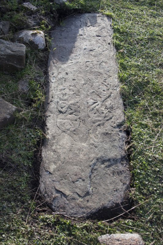 Late medieval burial slab within the church, with sword and foliate carvings in the style of the Iona school