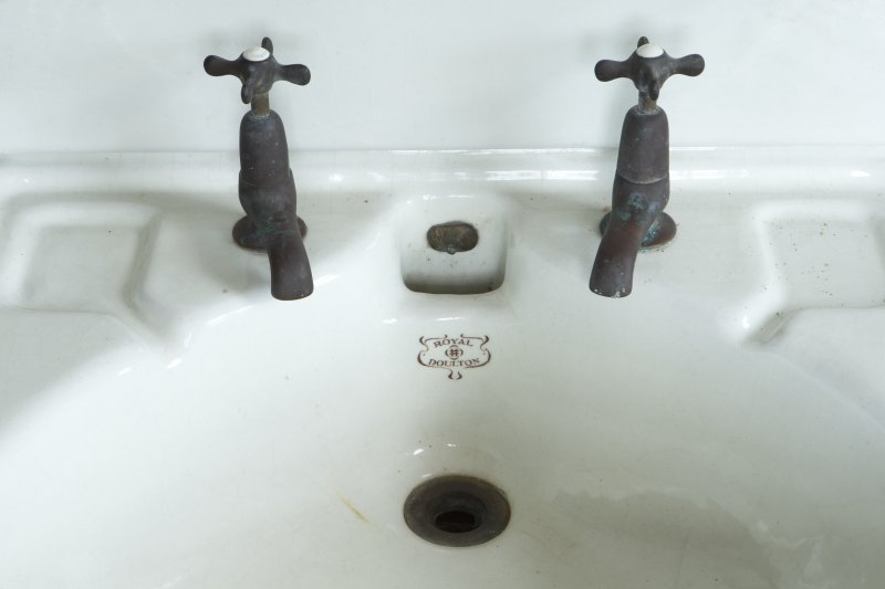 2nd floor, north east bathroom, detail of taps and maker's name (Royal Doulton) on wash-hand basin