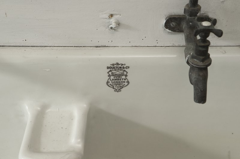 2nd floor, north east bathroom, detail of maker's name (Royal Doulton) on wash-hand basin