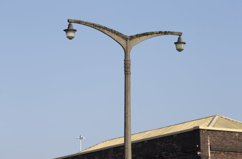Concrete lamp post outside office block, detail of top section