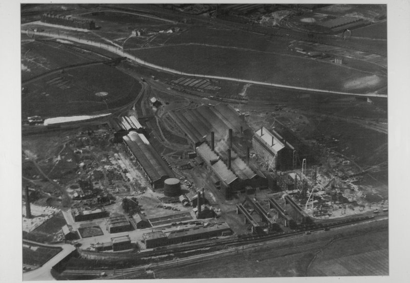 Copy of aerial photograph of Provan Works showing purufier house and oxide store (left), the original 1903 horizontal retort house (with 4 chimneys) and the 1921 vertical retort house (right). Coal stores are the low buildings beyond. Coke store is at south end of the site low level railway sidings (bottom right).