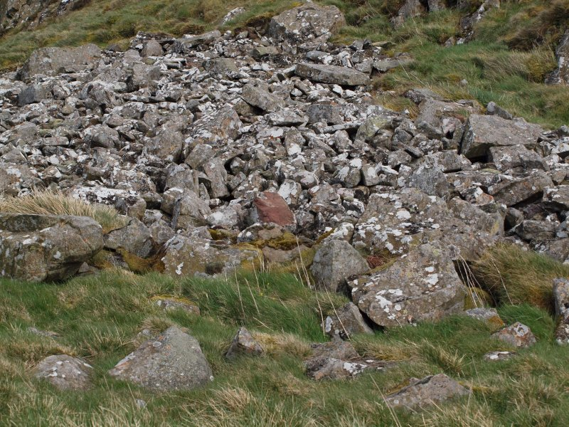 A possibly Roman block of sandstone in the screes on the SW side of the gully N of the summit