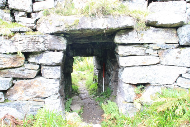 View of entrance passage from broch interior, from S