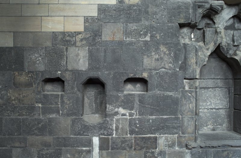 Choir, detail of recesses in south wall to east of original elders' seats