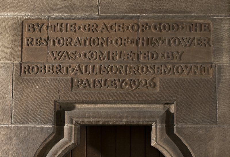 North transept, detail of inscription above door to tower