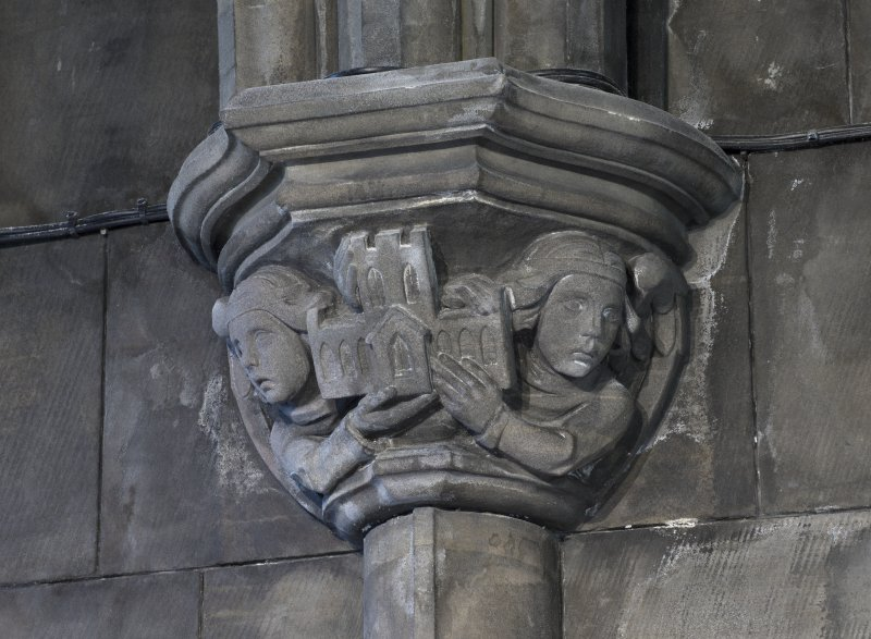 Sacristy, detail of capital with figures holding abbey