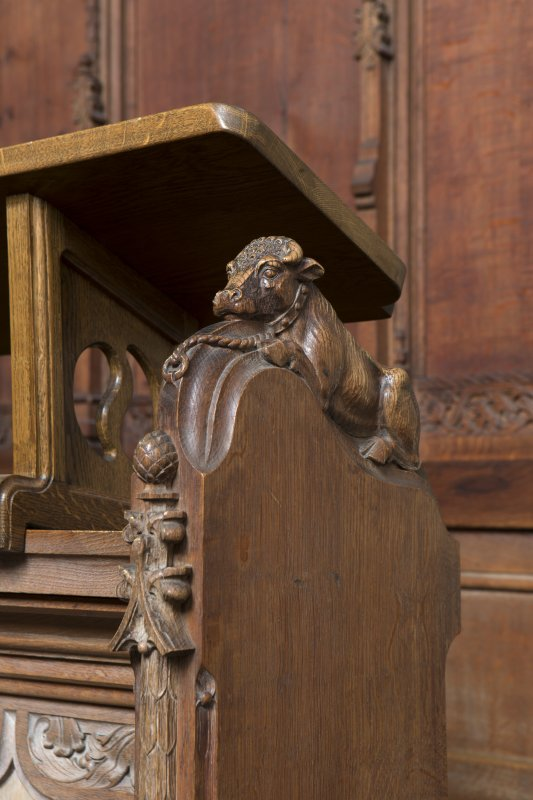 Choir, detail of carved bull on choir stalls