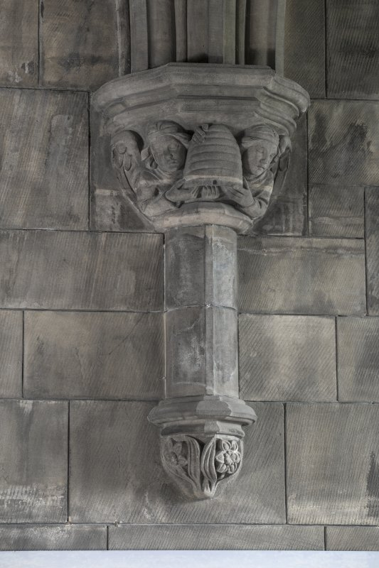 Sacristy, detail of corbel with figures holding beehive