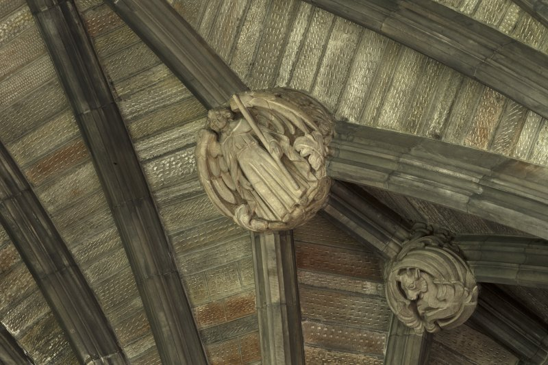 Choir, ceiling, detail of carved bosses with vaulting