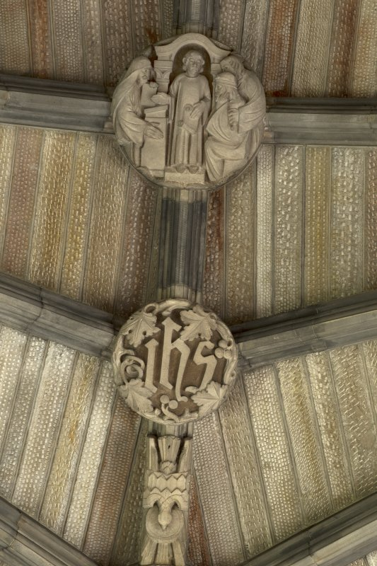 Choir, ceiling, detail of carved boss (Boy Jesus in Temple)