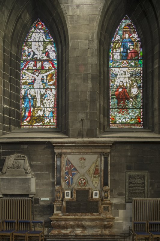 Crossing, north transept, view of war memorial with stained glass above