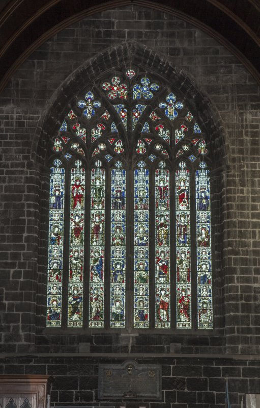 Crossing, north transept, view of stained glass window on north wall
