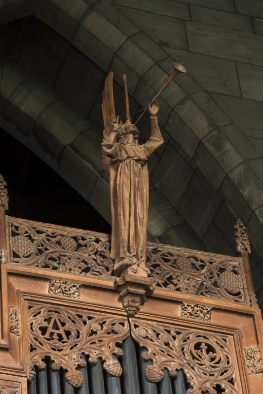 Choir, detail of carved angel on top of organ pipes