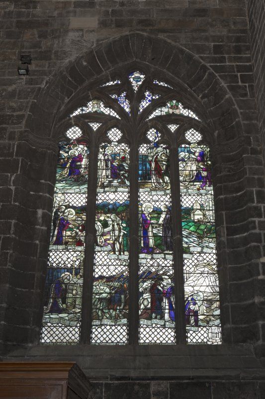 Crossing, north transept, view of stained glass window on west wall