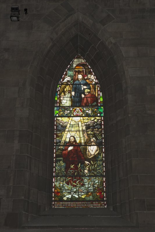 Crossing, north transept, detail of stained glass window on east wall