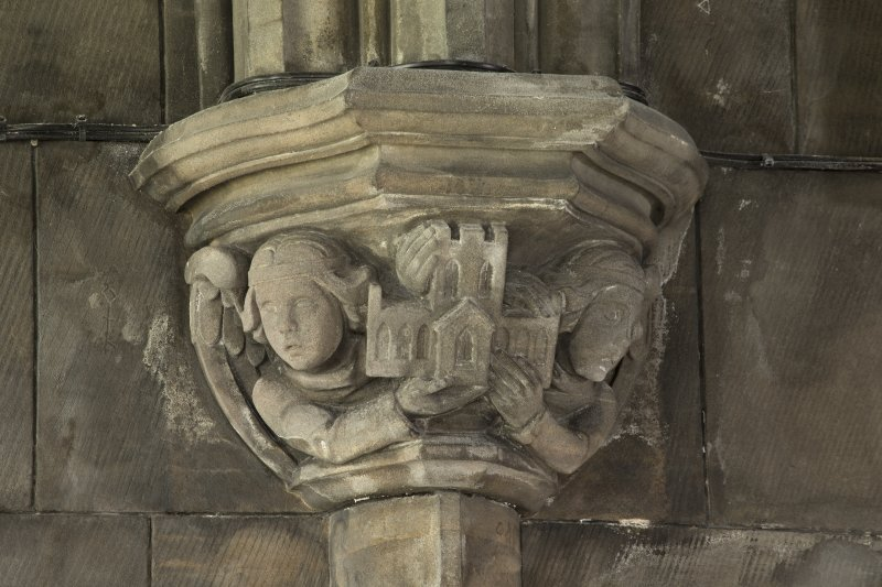 Sacrisy, detail of corbel with figures holding abbey
