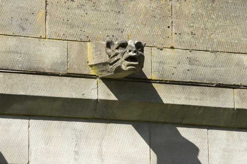 Cloister, north range, detail of gargoyle