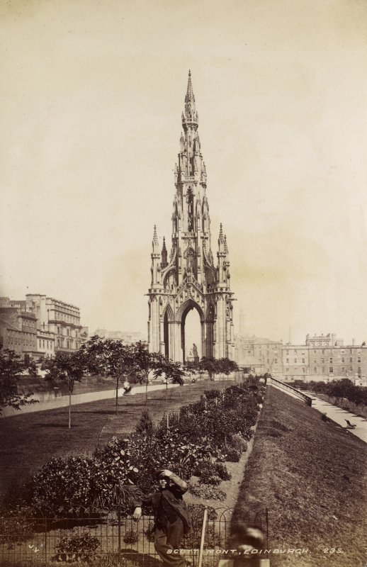 View looking east at Scott Monument and Gardens, Edinburgh. Titled 'SCOTT MONT, EDINBURGH, 235.' Photograph Album 25  Mr Dog Album