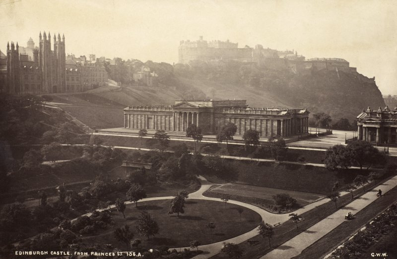 Distant view of Edinburgh Castle from Princes Street also showing National Gallery and Princes Street Gardens. Titled 'Edinburgh Castle from Princes Street, 156A, G.W.W.' PHOTOGRAPH ALBUM No.25: MR DOG ALBUM.