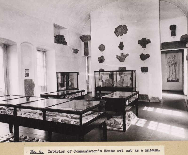 Interior view of Commendator's House, Melrose Abbey, showing museum display.