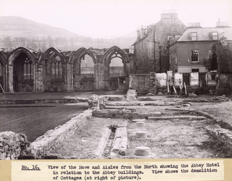 View of the nave and aisles, Melrose Abbey, from N, showing the Abbey Hotel and demolition of cottage.