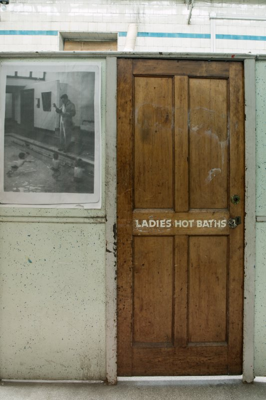 First floor. Ladies baths. Detail of door.