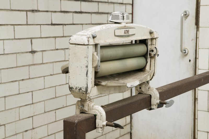 Ground floor. Washhouse. Detail of laundry wringer.