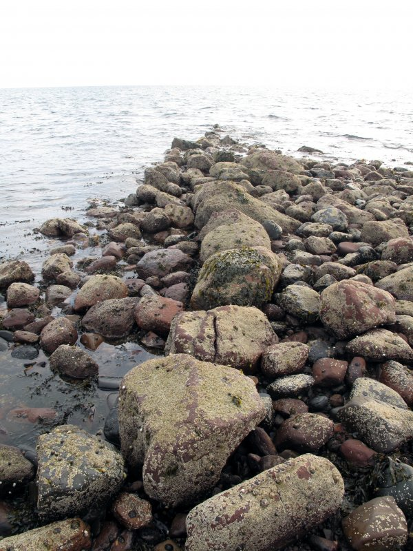 View of boulder wall on west side of harbour, looking south-west.