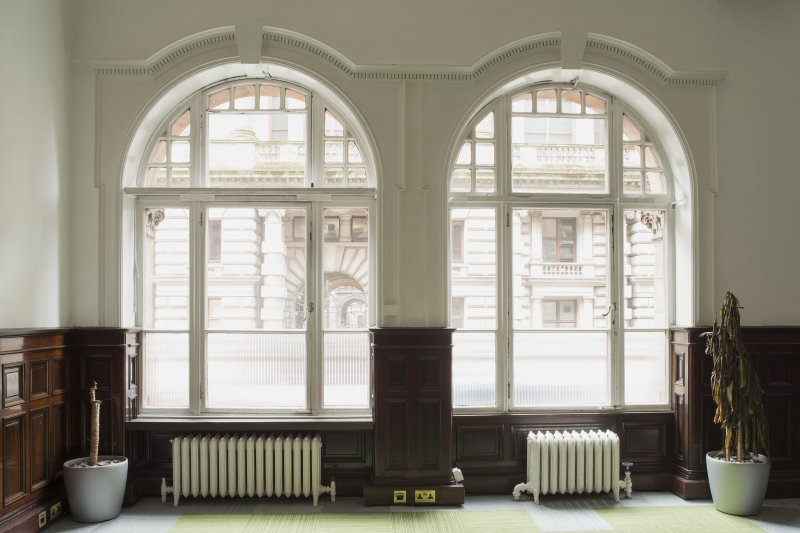 Ground floor. West office. Detail of arched windows.