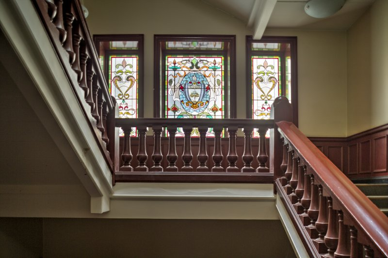 First floor. Detail of stained glass windows.