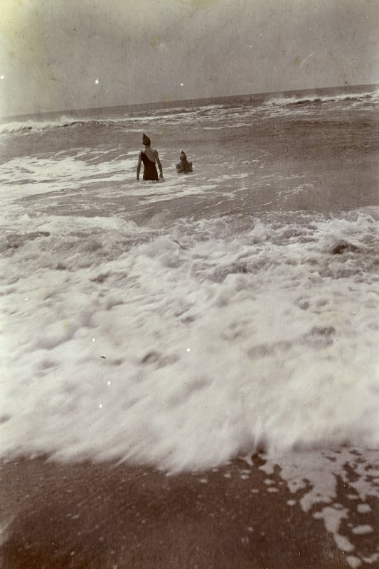Two men sea swimming, titled 'W Holt bathing at Adyar Bar', '21.7.07'.  PHOTOGRAPH ALBUM NO.116: D M TURNBULL