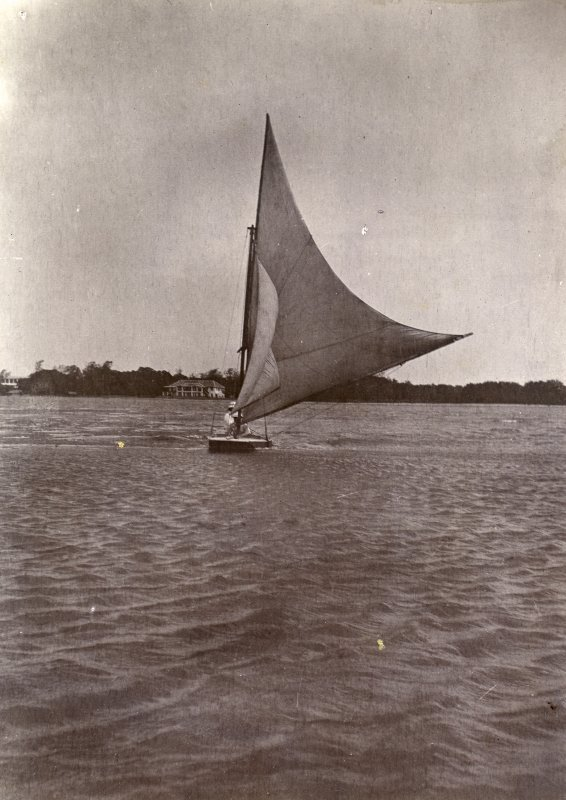 Sailing boat off the coast, titled'Messr Wilson, Farquharson on Mr Wilson's punt. Mr Jackson's house in background'. '21.7.07'.  PHOTOGRAPH ALBUM NO.116: D M TURNBULL