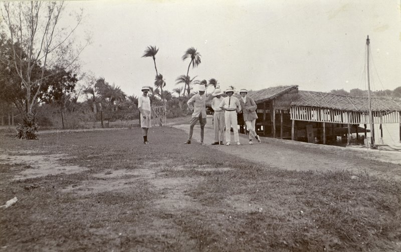 Four men standing on waterside, titled 'Messr Sandeman, Bud, Wilson, and Holt. Madras Boat Club. 21.7.07'.  PHOTOGRAPH ALBUM NO.116: D M TURNBULL