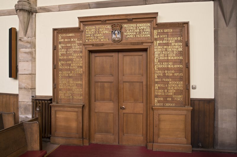 View of war memorial flanking doorway on north east wall (originally in Belmont Church)