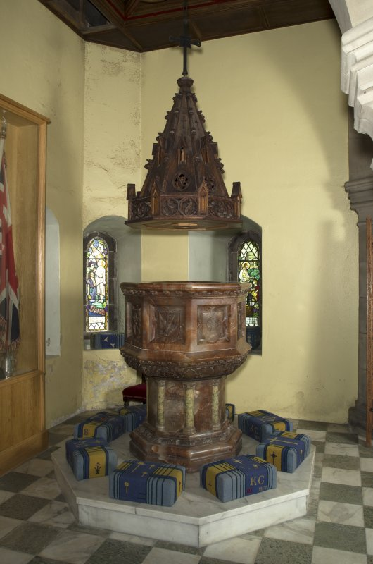 Baptistry, view of marble font with wooden canopy
